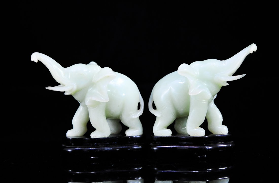 Pair of Chinese jade elephants on wooden bases