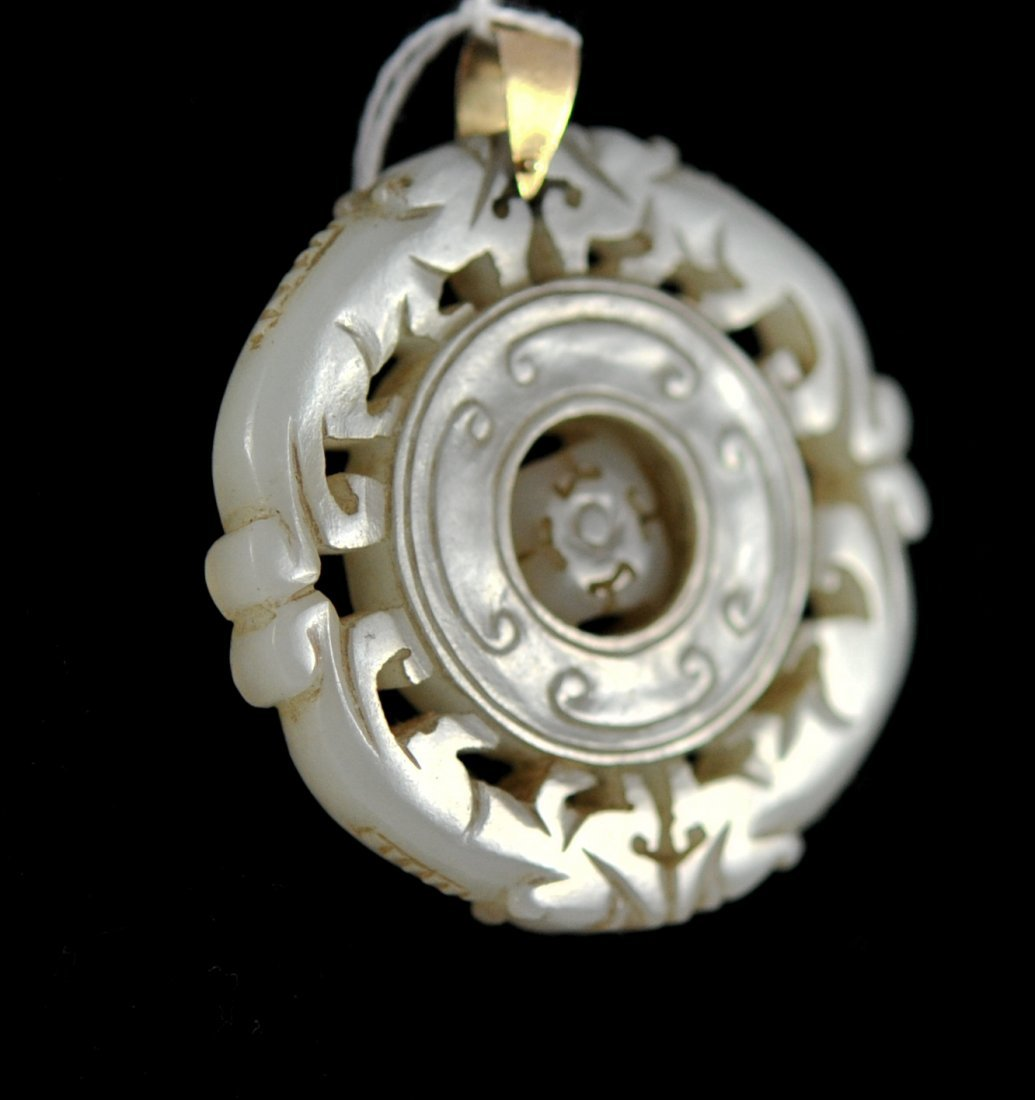 Chinese white jade and 14k mechanical discus pendant
