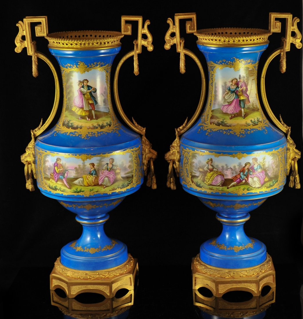 Pair of porcelain Sevres hand painted urns