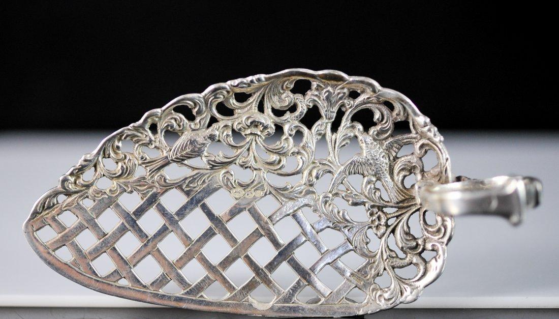 Antique ornate Dutch silver absinthe spoon. Hallmarked