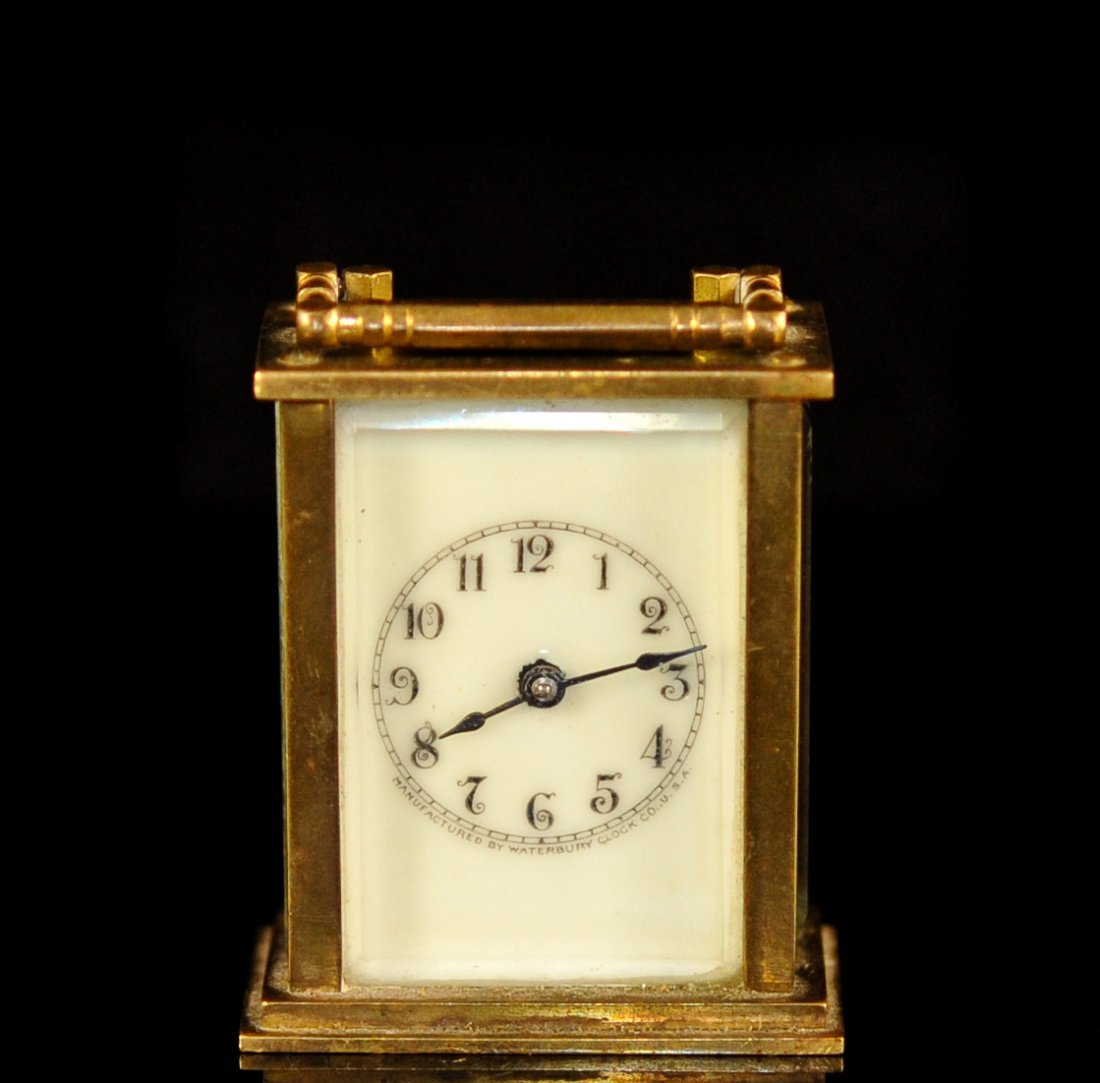 Small dore metal, glass and porcelain carraige clock