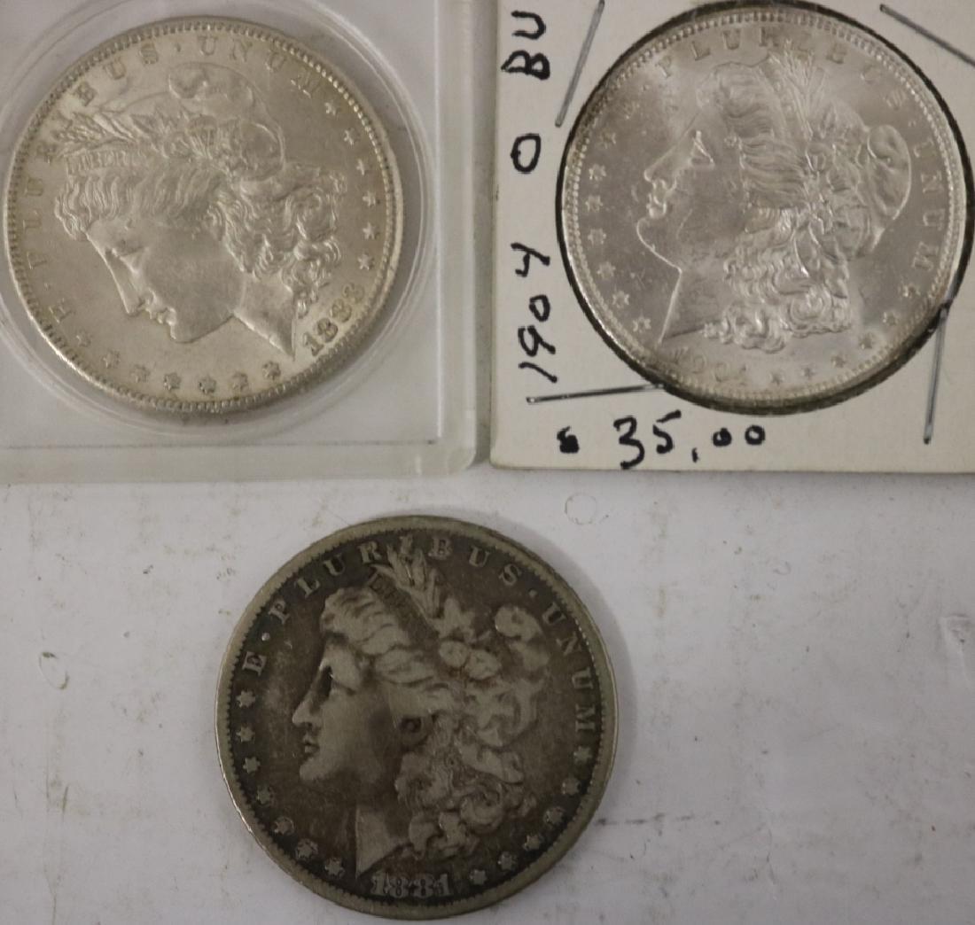 3 MORGAN SILVER DOLLARS INCLUDING A 1904-O IN BU