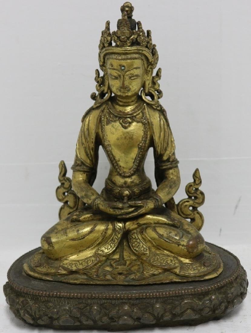 19TH C GILT BRONZE SEATED BUDDHA ON A CLOUD FORM