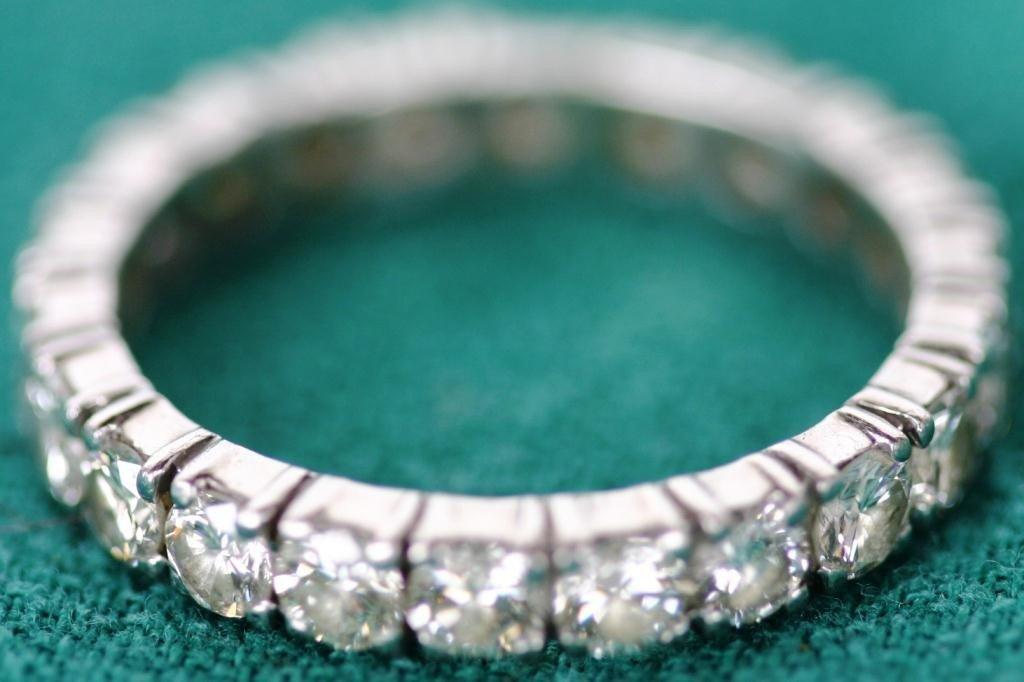 87: PLATINIUM DIAMOND ETERNITY BAND CONTAINING