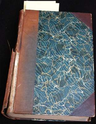 LEATHER BOUND BOOK WITH MARBLEIZED BOARDS,
