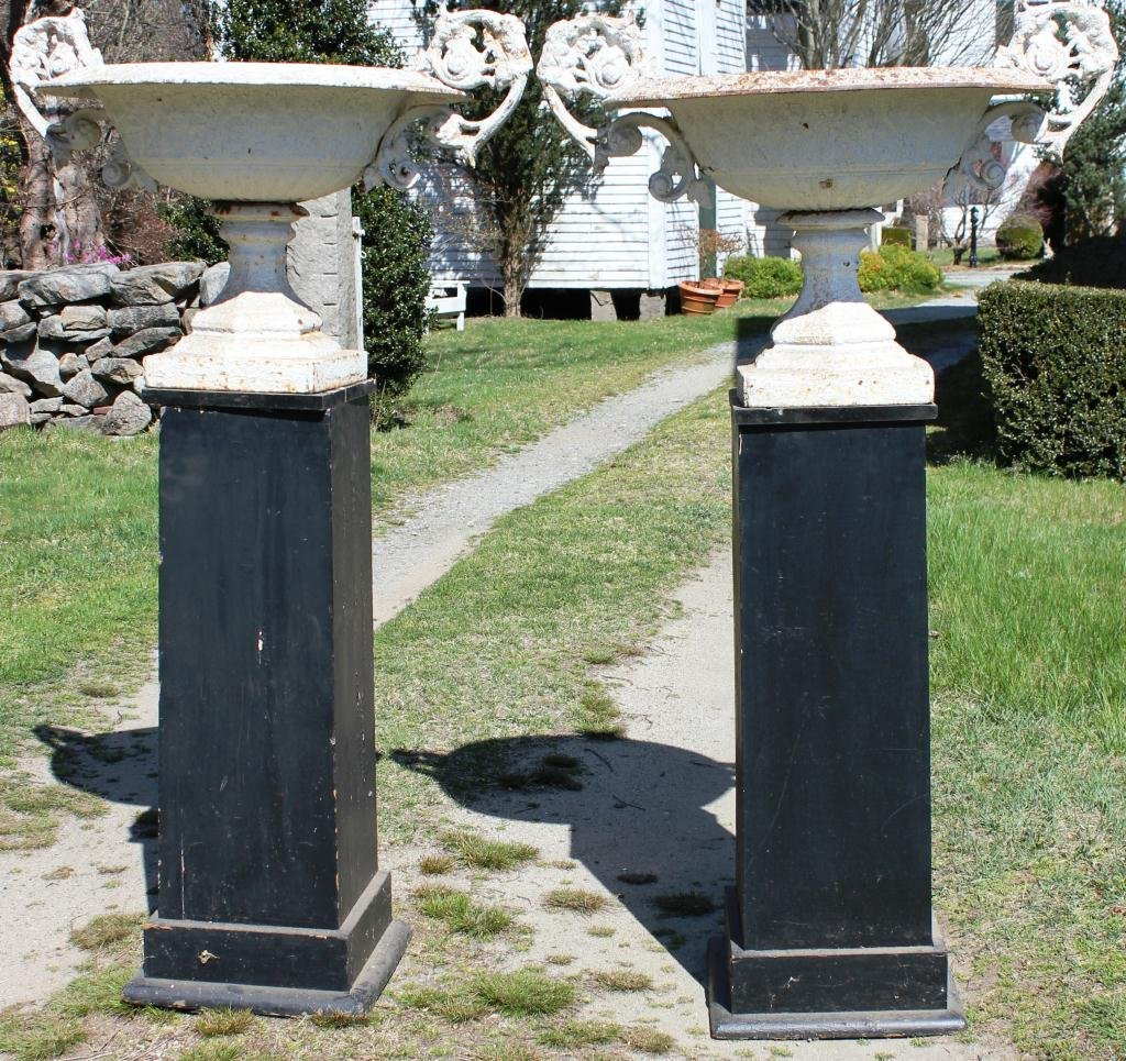 13: PAIR OF CAST IRON URNS WITH ORNATE