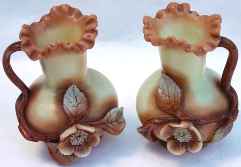 PAIR OF ENGLISH ART GLASS EWERS, RAISED FLORAL