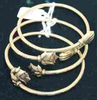 THREE 18KT GOLD BANGLE BRACELETS, 48.7 DWT,