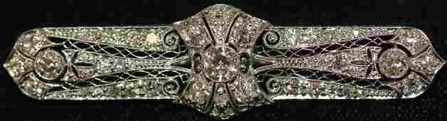 DIAMOND AND PLATINUM BAR PIN. OVER 1 CARAT OF