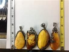 Four Amber/ Silver Pendants