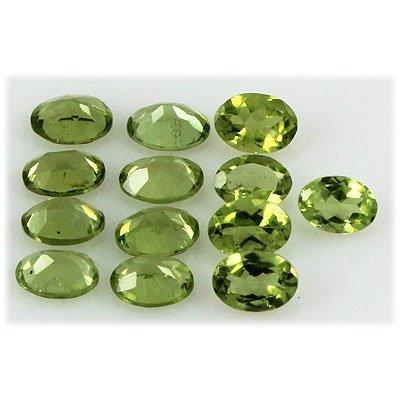 Peridot 10.98 ctw Loose Gemstone 7x5mm Oval Cut