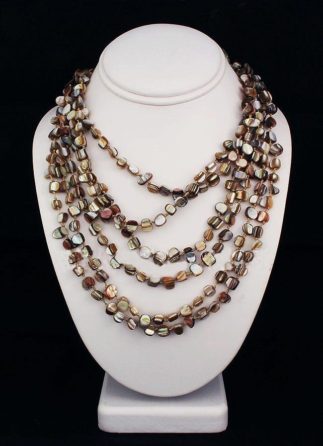 594.50CTW NUTMEG 6 ROW MOTHER OF PEARL NECKLACE