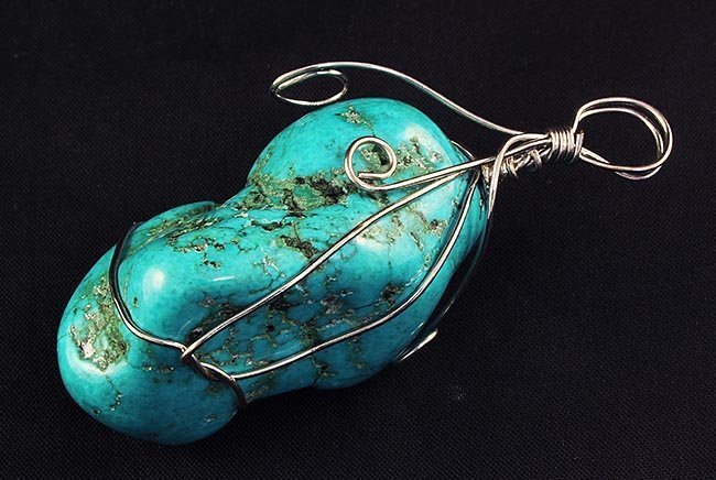 NATURAL 222.57CTW TURQUOISE WIRE WRAPPED PENDANT
