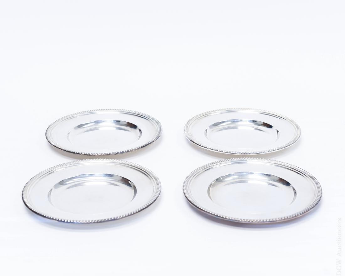 (4) Gorham Sterling Silver Plates.