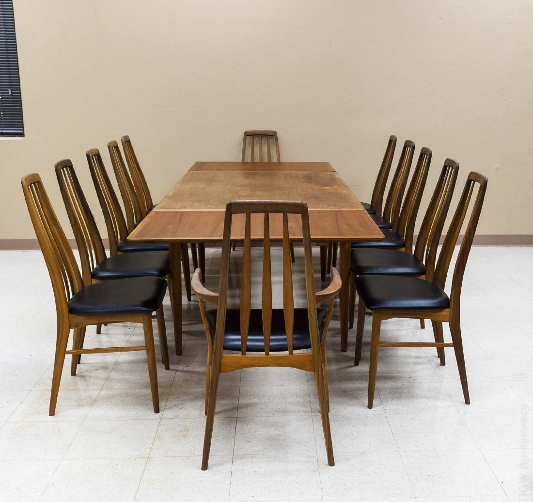 Teak Draw Leaf Table w/ 12 Danish Teak Chairs.