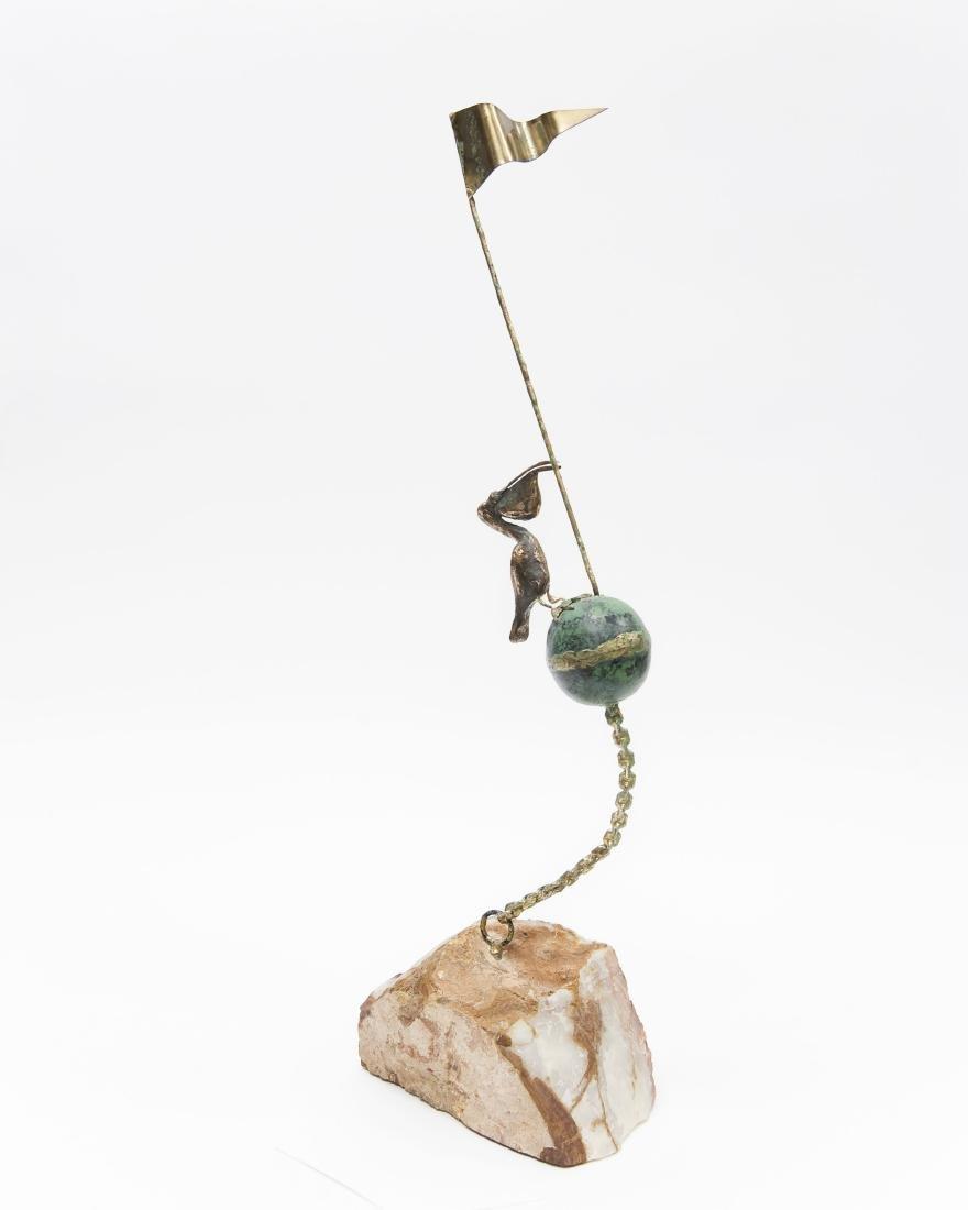 C. Jere Pelican on Sphere Sculpture.