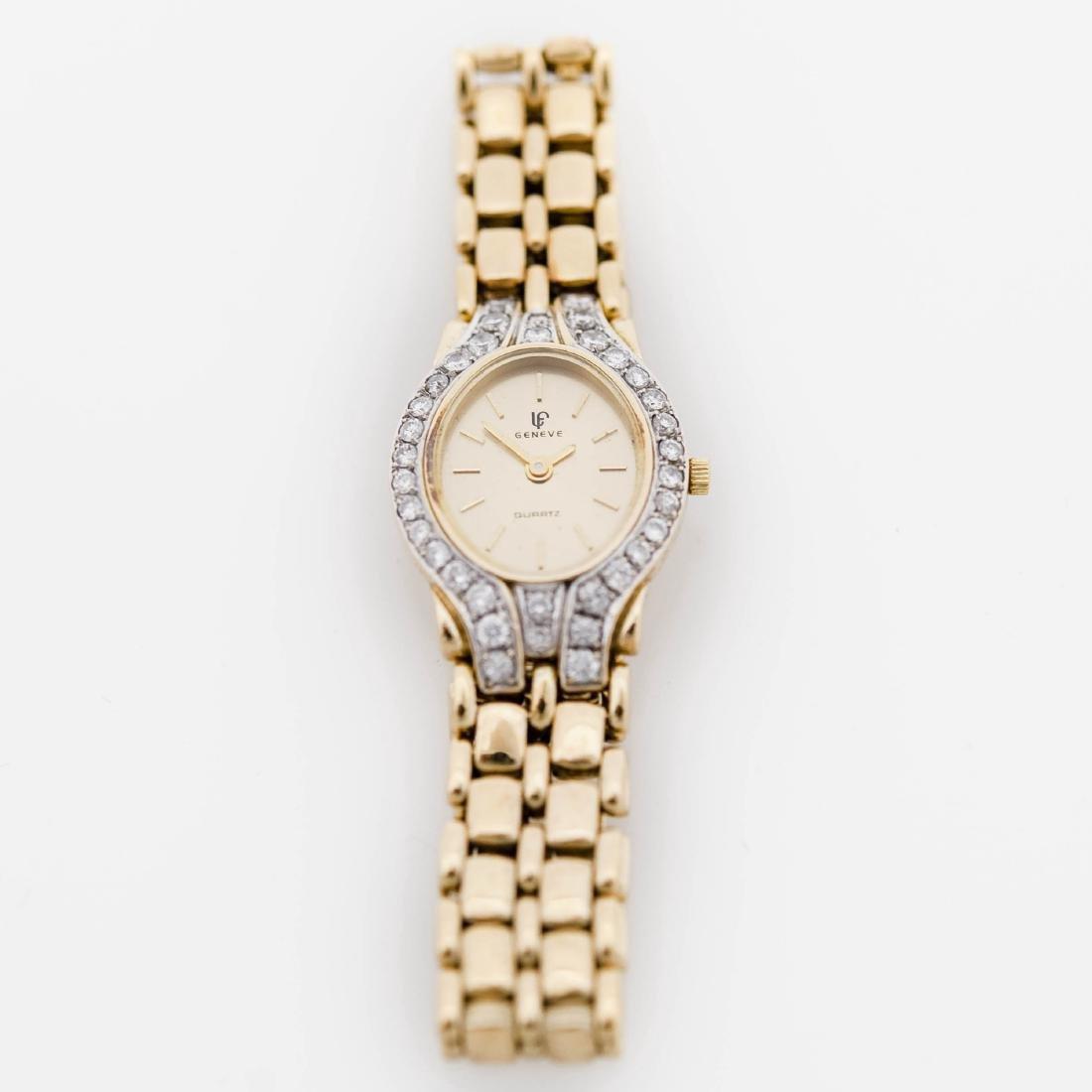 Lady's 14K Geneve Diamond Bezel Wristwatch.