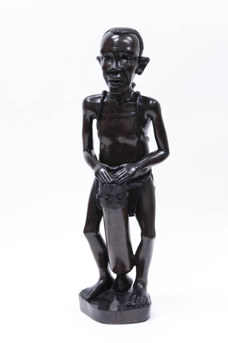 African Carved Wood Sculpture, Man with Drums.