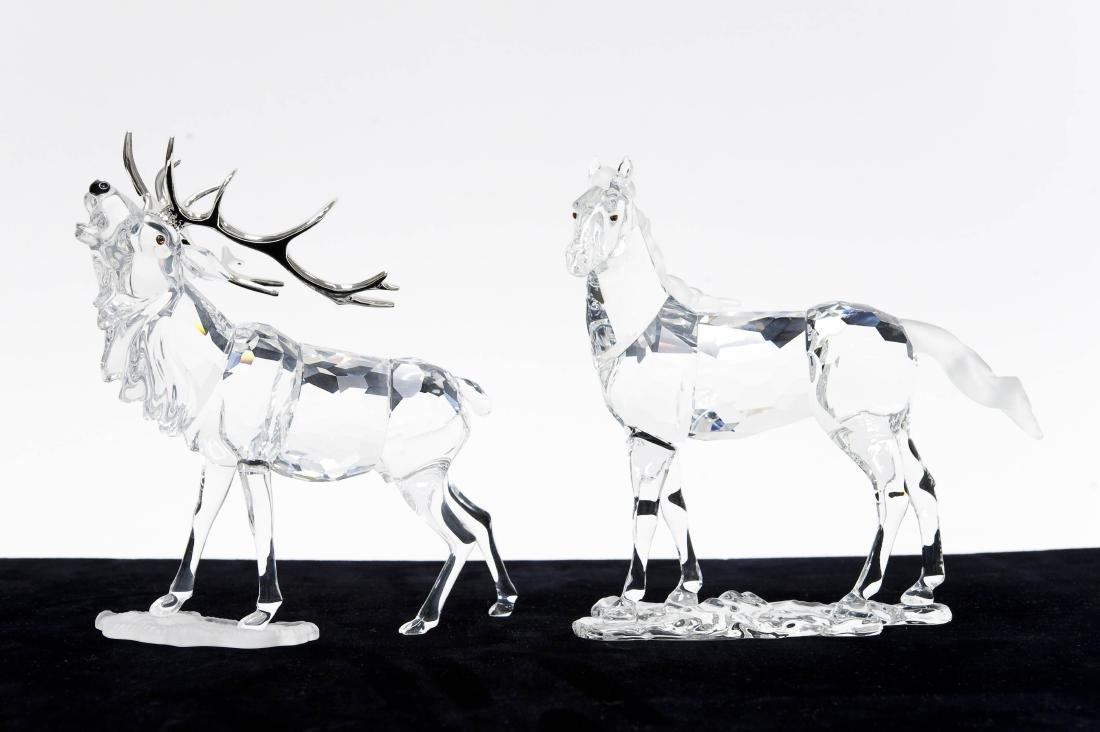 (2) Swarovski Crystal Sculptures.