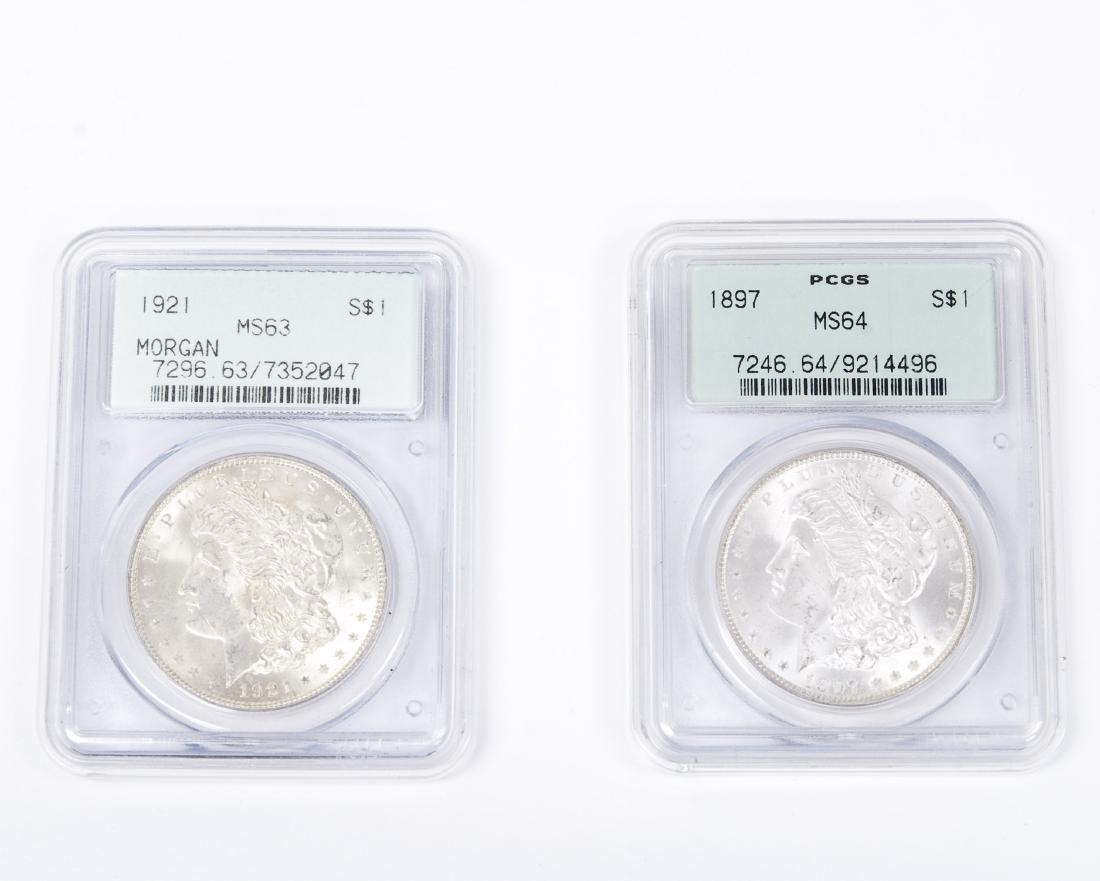 (2) Morgan Silver Dollars, Graded.