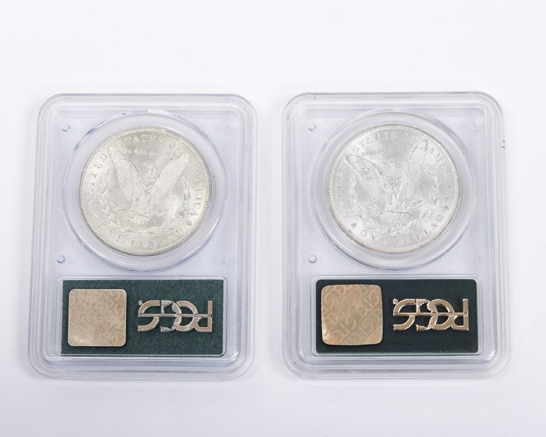 (2) Morgan Silver Dollars, Graded. - 2