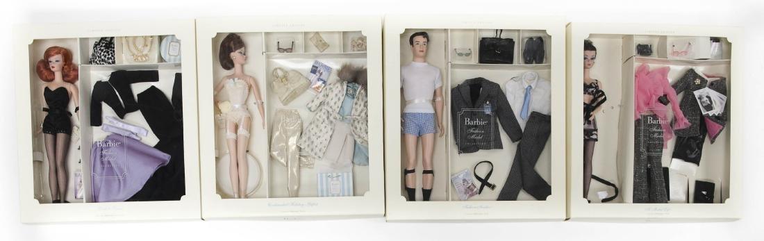 (4) Fashion Model Barbie Dolls.