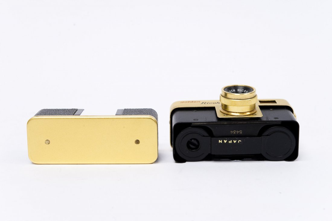 """Golden Ricoh """"16"""" Camera with Case. - 7"""