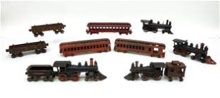 Group of (11) Antique Cast Iron Locomotives and Tender.