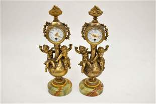 Pair of Continental Style Gilt Metal Mantel Clocks.