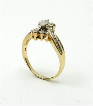 14K Yellow Gold and Diamond Ring.