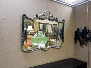Continental Ebonized and Gilt Framed Wall Mirror.