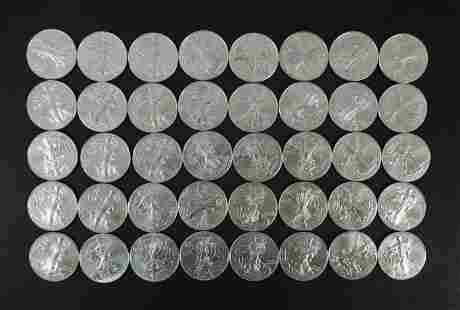 (40) American Silver Eagle Dollars.