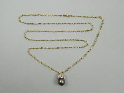 14K Yellow Gold Chain with Black Pearl Pendant.
