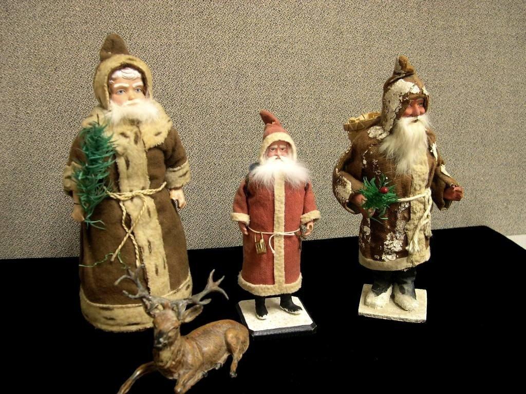 18: (3) Victorian Santa Claus fugures