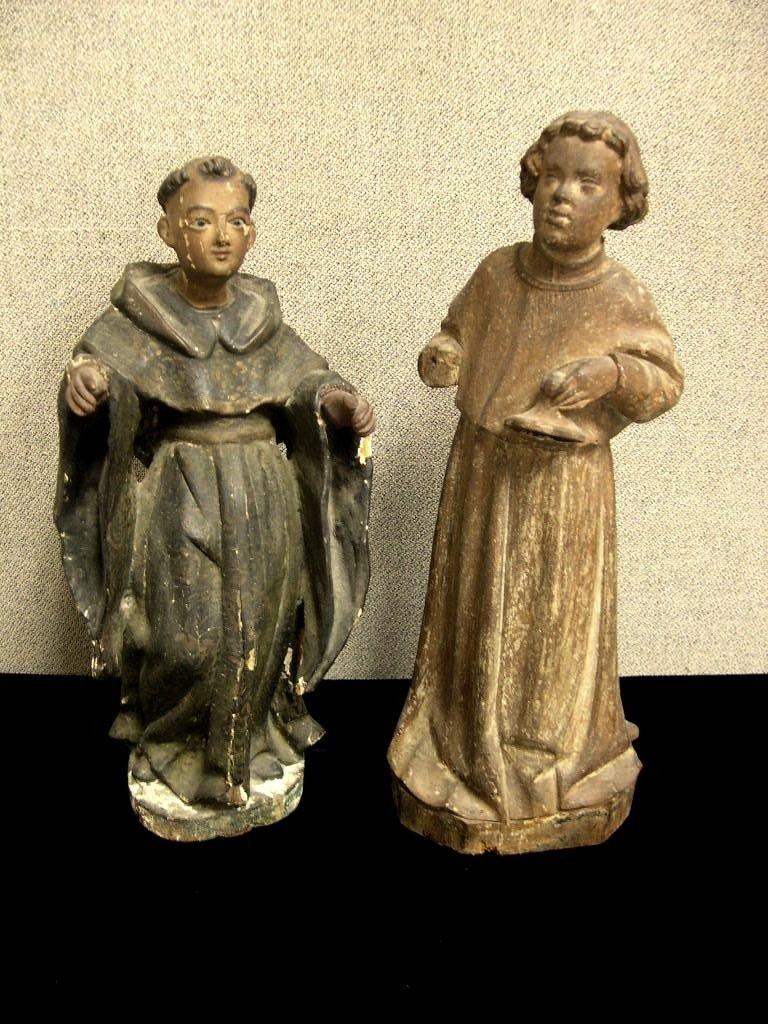 19: 2 Carved wood Santos Figures