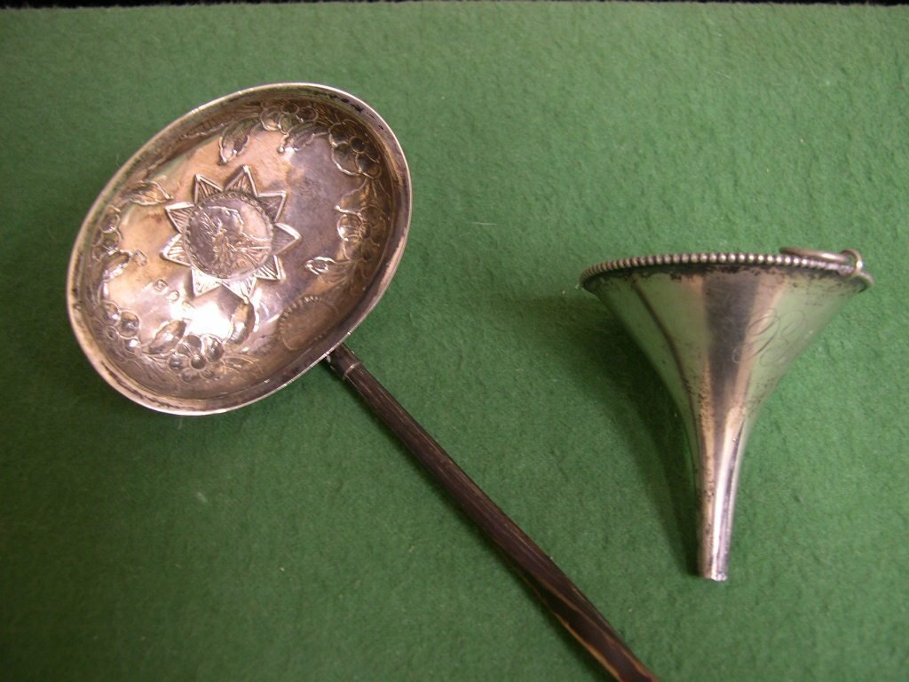 9: Silver ladle and a Wine funnel