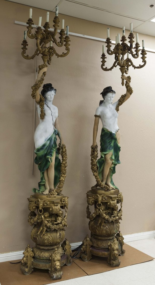 Pair of Bronze Figural Torcheres.