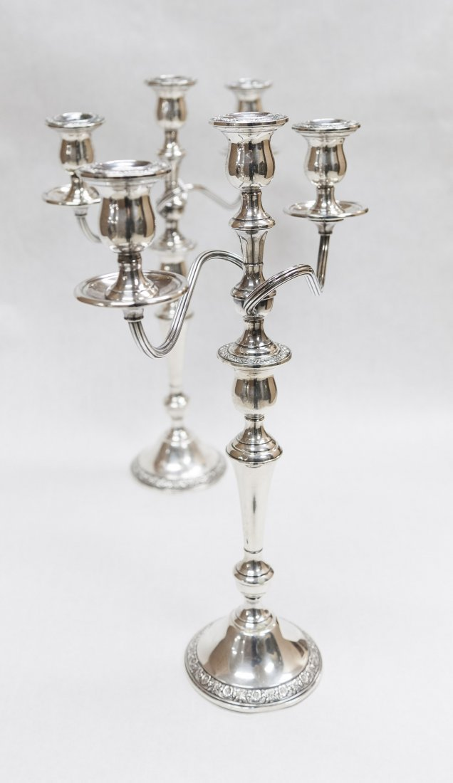 Pair of Sterling Silver Candelabra. (weighted).