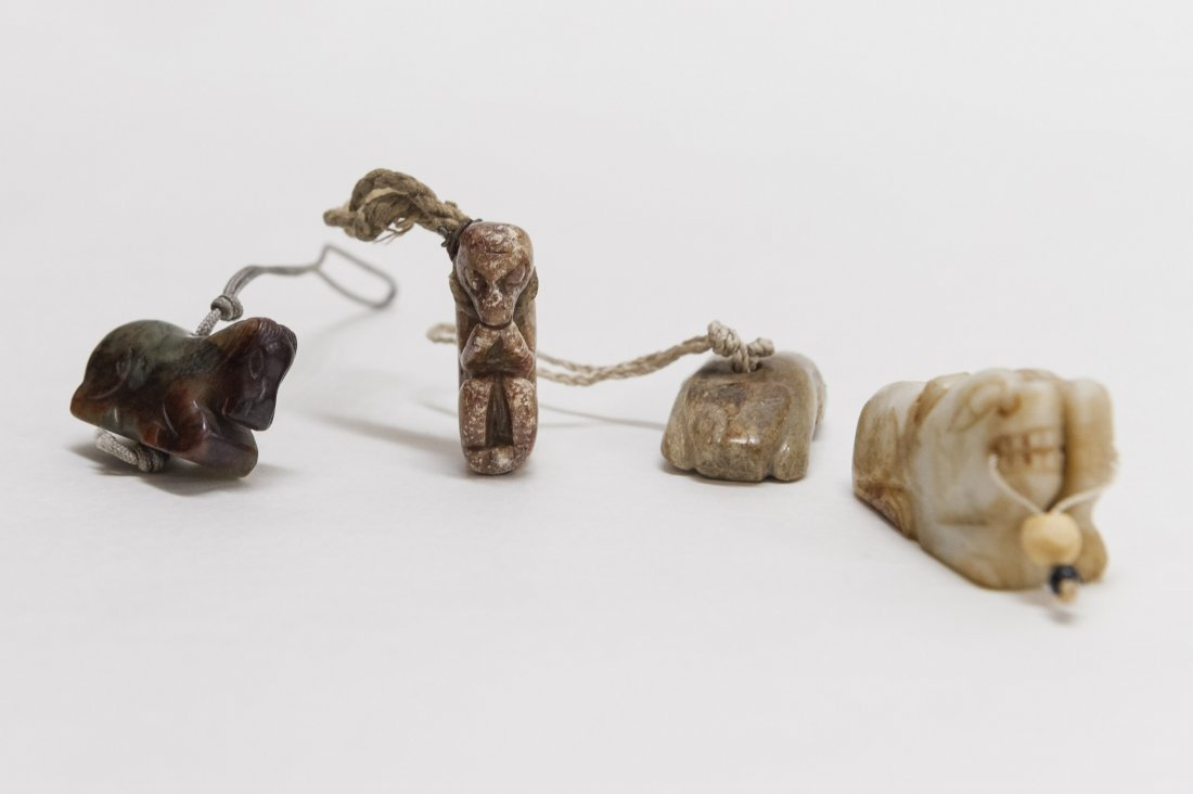 Four (4) Carved Hardstone Toggles