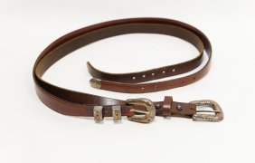 (2) Leather Belts with Gold and Silver Buckles.