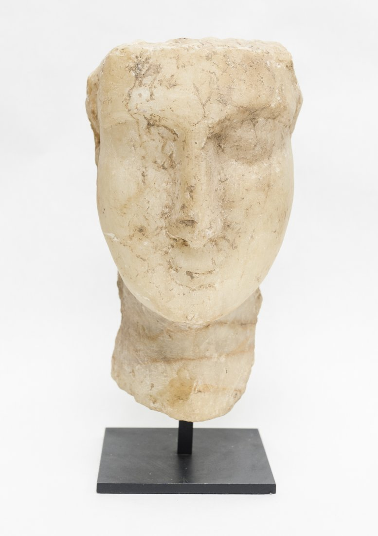 Gandharan carved schist stone study of a head.