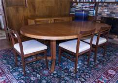 Danish Teak Dining Table with 6 Associated Chairs.