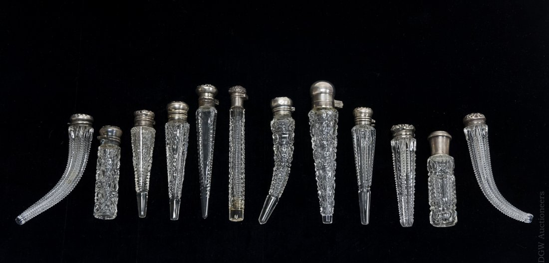(12) Cut Glass Perfume Bottles with Sterling Caps.
