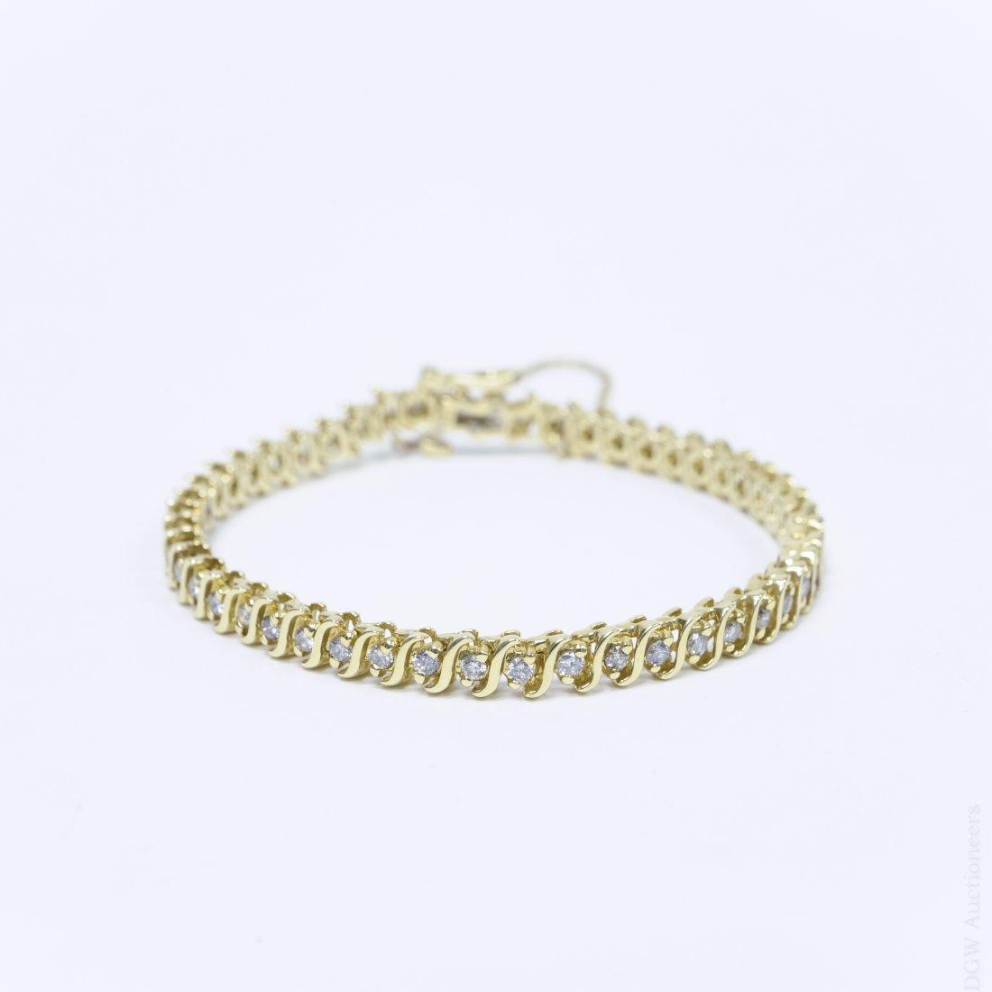 14K Yellow Gold and Diamond Tennis Bracelet.