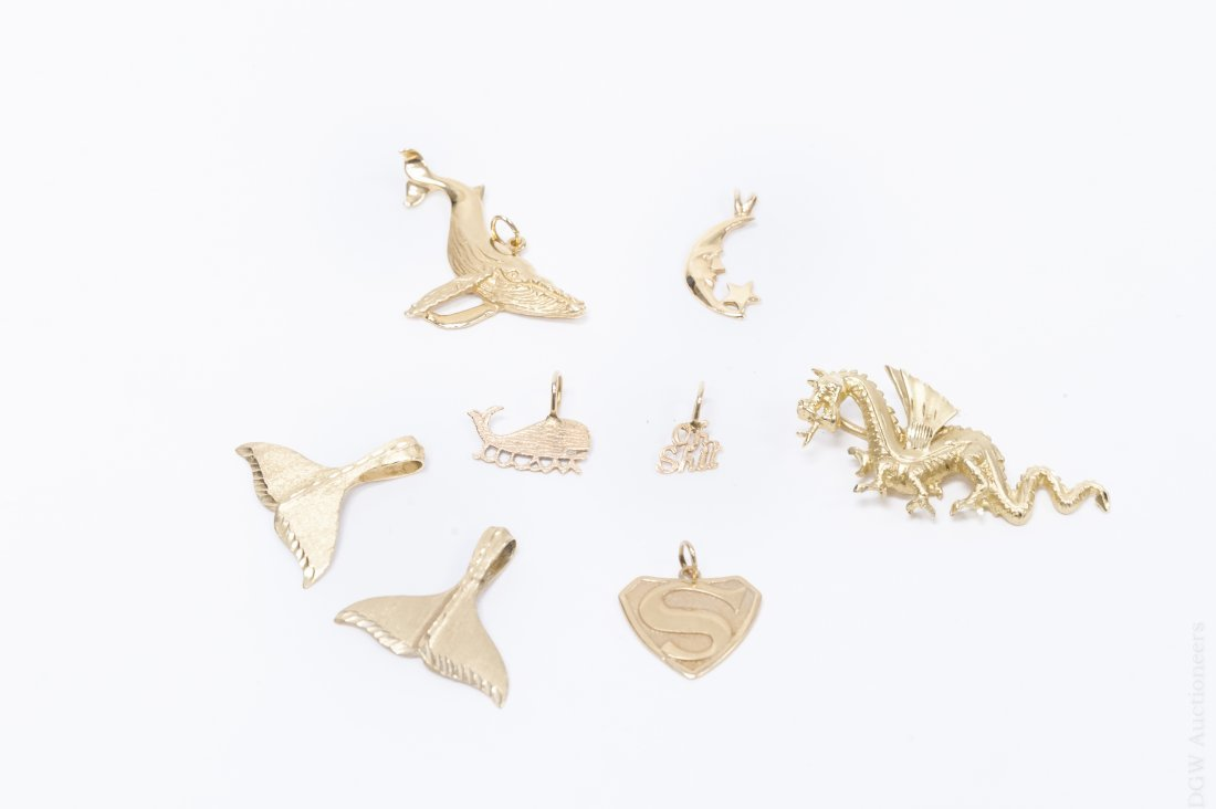 (8) 14K Yellow Gold Charms.