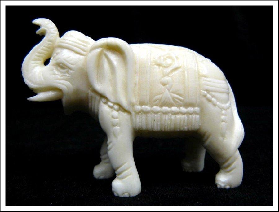 1J: HAND CARVED BONE SADDLED ELEPHANT