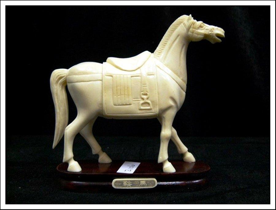 5J: HAND CARVED BONE SADDLED TANG HORSE