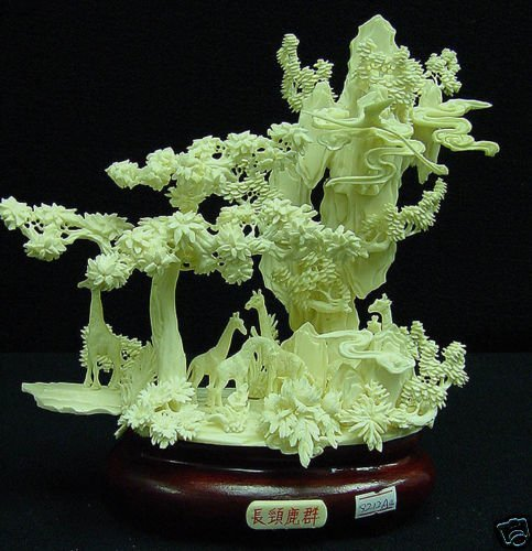HAND CARVED SOLID BONE GIRAFFS MOUNTAIN