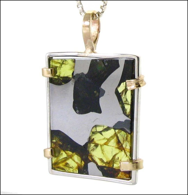 A PALLASITE METEORITE WITH BEAUTIFUL PERIDOT CRYSTALS