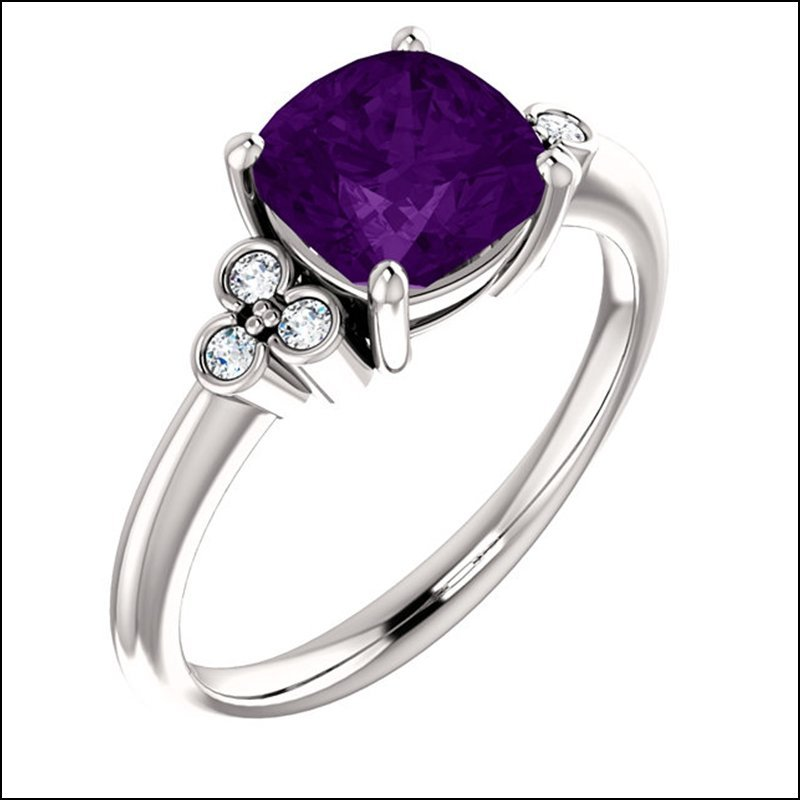 GEMSTONE RING WITH BEZEL ACCENTS